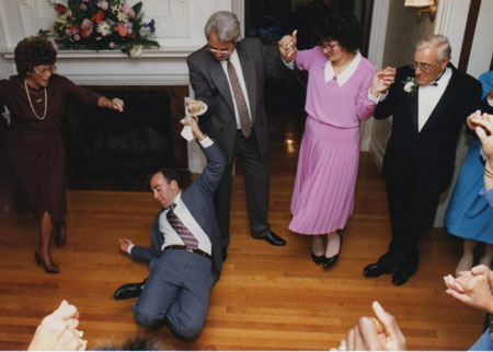 Joe dancing with his father and family at his sister's wedding